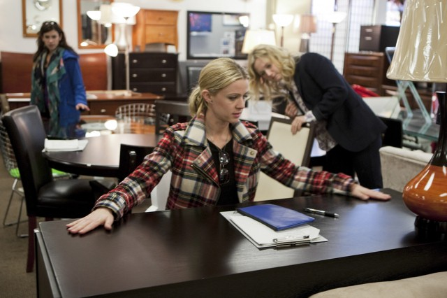 Casey and Emily size up a desk for their fourth challenge, while Stacey Cohen looks on.