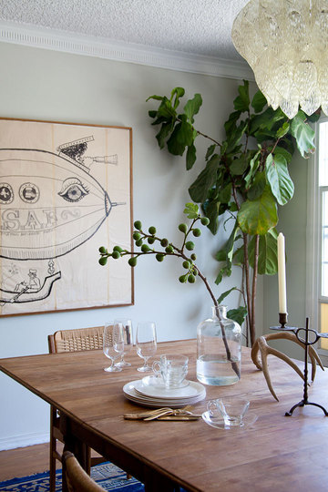 Emily's dining space features this curious blimp art.