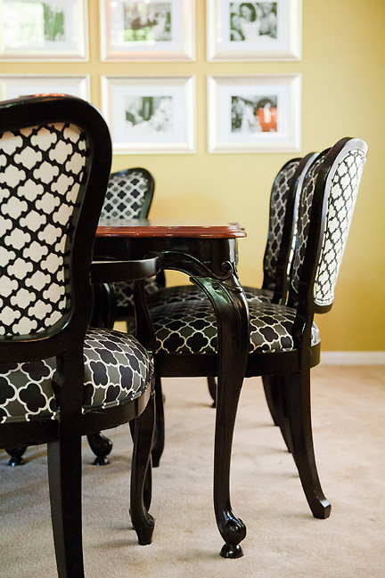 Antique dining table and chairs refinished in black lacquer and walnut, and reupholstered in black & white trellis patterned fabric. Designed by Room Fu - Knockout Interiors.