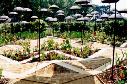 Artistic garden exhibit in Loire Valley in France included this one with black umbrellas.