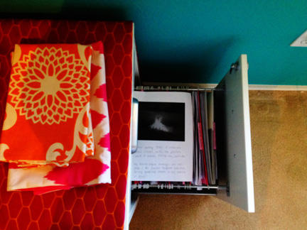 Feng shui reminders--a picture of a volcano erupting in my wealth & prosperity corner.