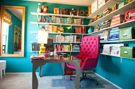 Room Fu Design Guru Robin Callan's home office features teal walls and a hot pink, tufted, mid-century swivel chair.