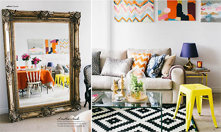 This spread in the Feb/Mar 2013 issue of Australia's online home decor magazine, Adore, features a black & white ikat rug and colorful pillows and art.