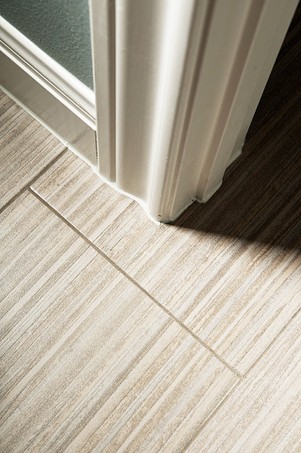 modern bathroom floor browns grays striped tile
