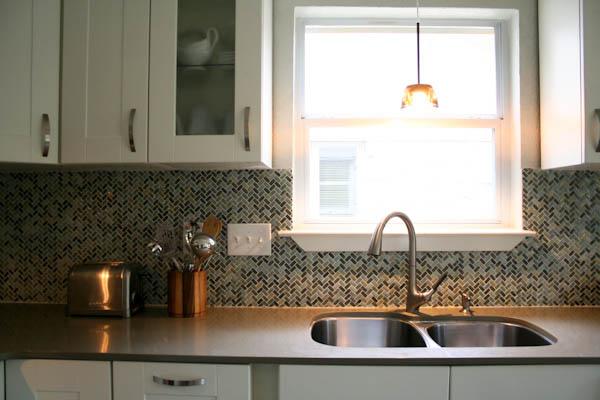 Austin kitchen remodel white shaker cabinets quartz countertops modern herringbone backsplash