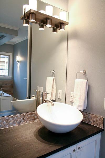 benton_master_bath_double_vanity_leathered_counter_penny_marble_backsplash_modern _white_cabinets_3