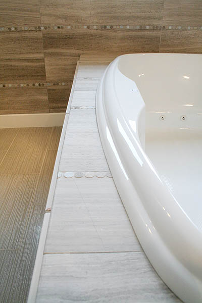 benton_master_bath_tub_marble_penny_tile_neutral_modern 2