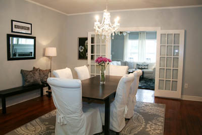 sm_white dining room slipcovered chairs crystal chandelier gray walls 1