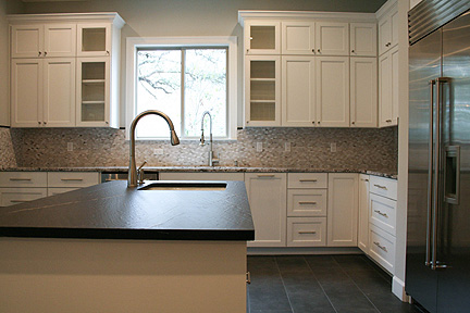austin-white-kitchen-black-leather-island-countertop_web
