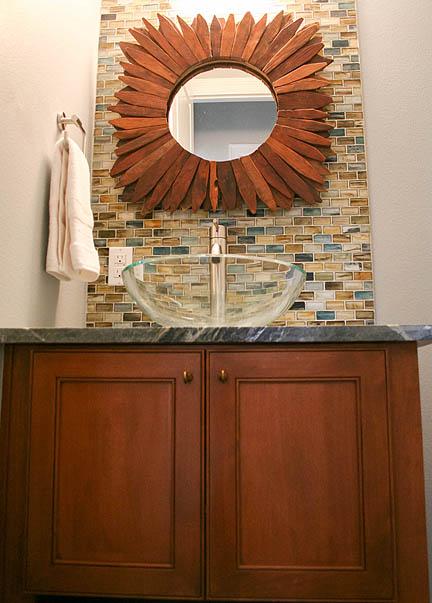 glass-tile-natural-colors-soapstone-countertops-teak-wood-starburst-mirror-austin-powder-room3_web