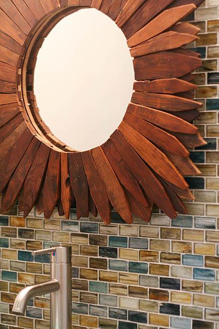 glass-tile-natural-colors-soapstone-countertops-teak-wood-starburst-mirror-austin-powder-room_web