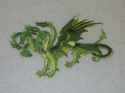 Detail of embroidered dragon on upholstery.