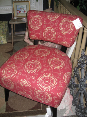 Armless chair covered in raspberry Annie Selke fabric.