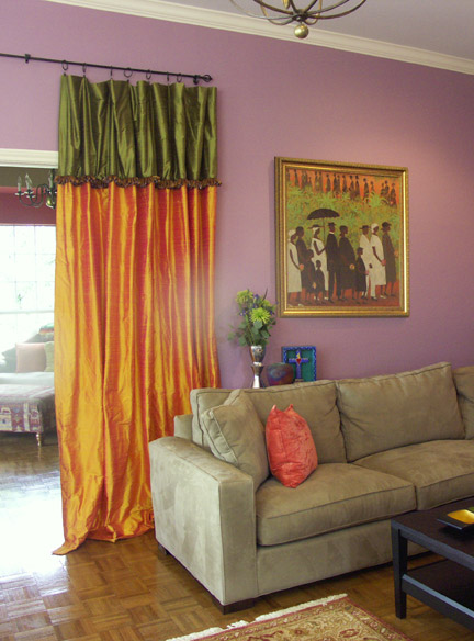 AFTER: A neutral, brown sectional sofa comes alive in front of violet purple painted walls.