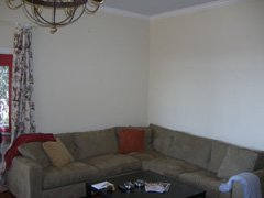 BEFORE: A neutral, brown sectional sofa looks incredibly boring in front of builder beige walls.