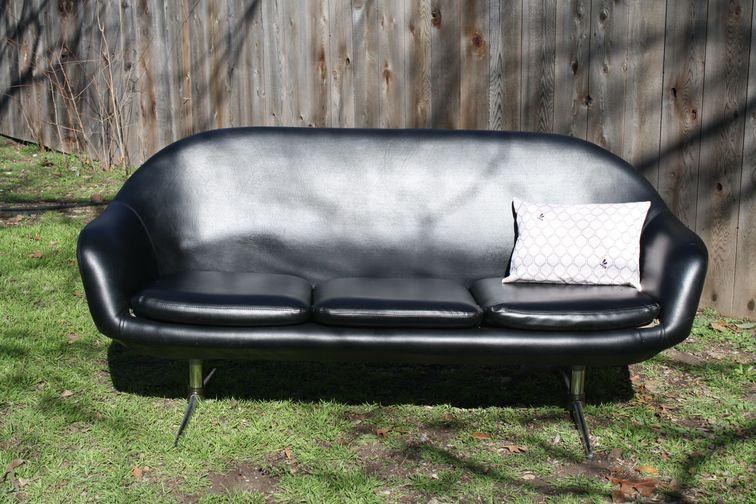 Mid-century black vinyl Overman sofa, $350