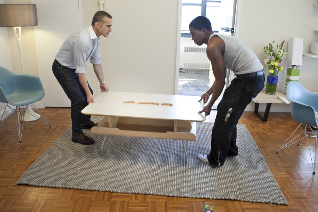 Tom and Alex load their living room during the fourth challenge.