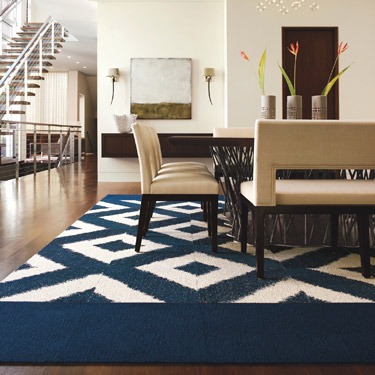FLOR rug featuring Sophistikat and Feelin Groovy, both in Cobalt.