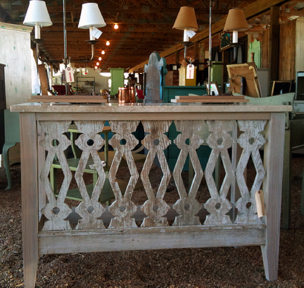 Console table made from the railing on a veranda.