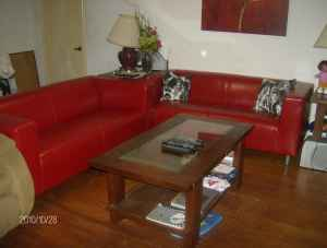 Pair of red vinyl sofas, $300.