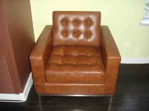 Tufted leather chair, $200, OBO.