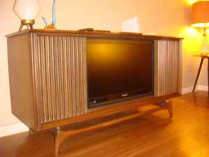 Truly special! This great-looking TV console is tricked out with a flat-screen TV and Harmon Kardon sound. $1,500.