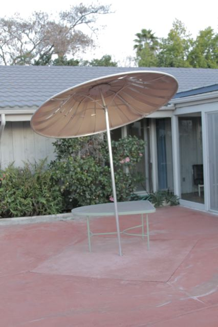 Aluminum, rotating, outdoor umbrella, $400.