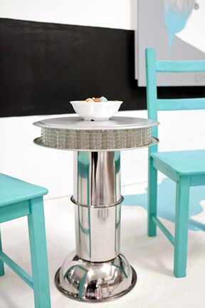 Kellie's Hollywood Regency side table made from salt shakers, pizza pans, and paint cans.