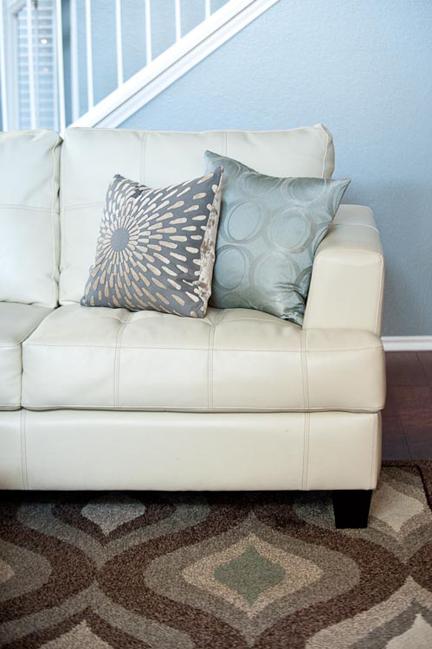 cream-leather-sofa-spa-gray-beige-pillows