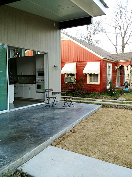 Open this huge sliding door and the back porch easily extends the living space.