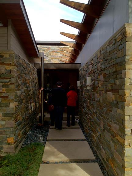 A mix of natural materials makes this entrance inviting.