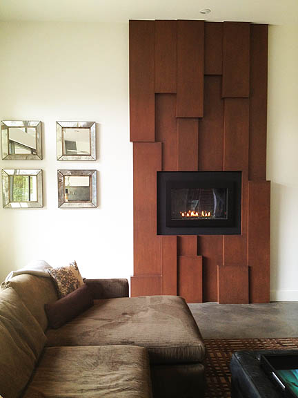 This modern fireplace facade is not only great-looking, it's also very budget-friendly and relatively easy to DIY.