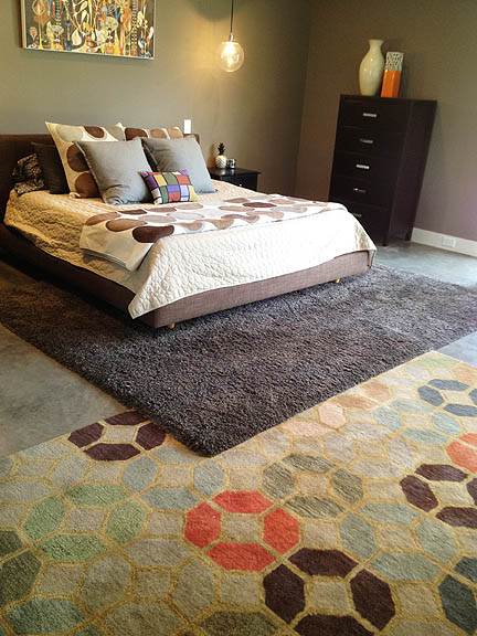 This is how you work layered rugs! I'm also dying for the Rex Ray over the bed.
