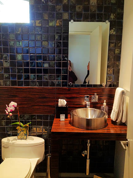 Love the band of zebrawood across the backsplash in this powder room.