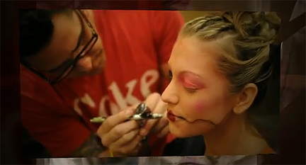Luca Paganico airbrushes a model's face.