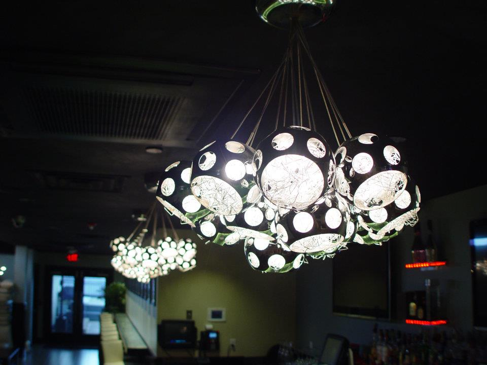 Love these pendants over the bar.