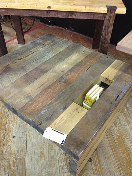 An awesome handmade table with a built-in book/magazine holder.