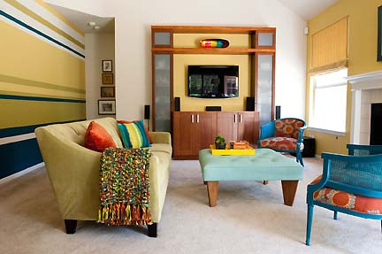 This colorful, modern living and family room in Austin, TX features a bold color palette. Designed by Room Fu - Knockout Interiors. Photo by Suzi Q. Varin / Q Weddings.
