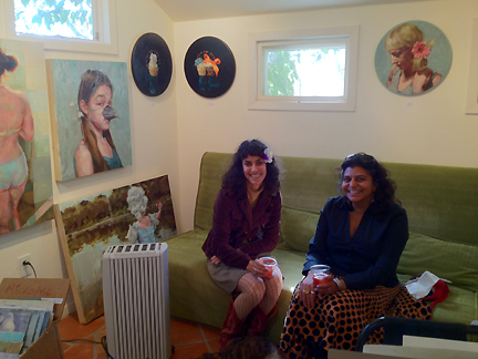 Jennifer Balkan in her studio, with a fan.