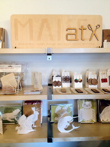 A display of jewelry and greeting cards at the MAKEatx studio.