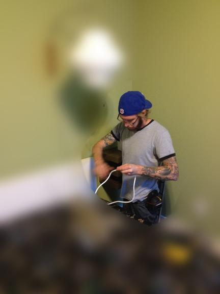 Bryan Cirelli of My Austin Handyman installs a wall-mounted sconce for us.