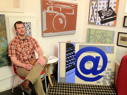 Matt Wester and his graphic-styled paintings at the Pump Project Art Complex.
