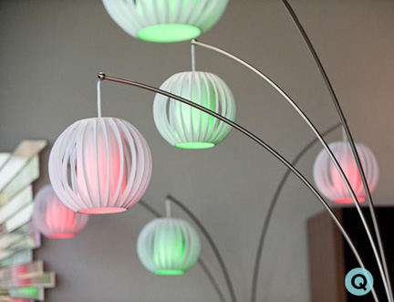 Austin's Five Elements Furniture turned this arc lamp into a holiday feature with colored bulbs.
