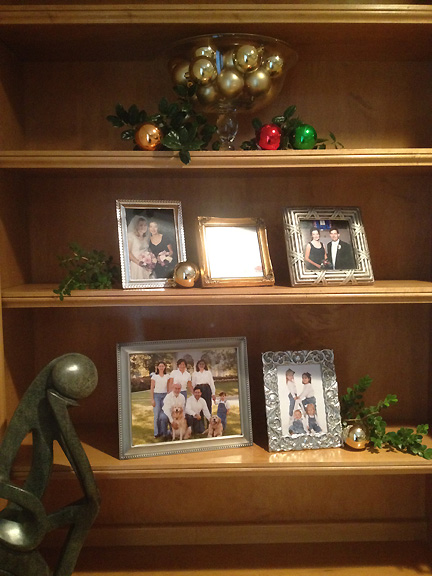 AFTER: Natasha's living room built-ins now feature family photos and holiday Christmas ornaments.