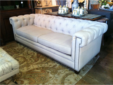 Modern tufted Chesterfield linen sofa with boxed arms and nailhead trim detail, available at Back Home Furniture in Austin, TX for $2189.