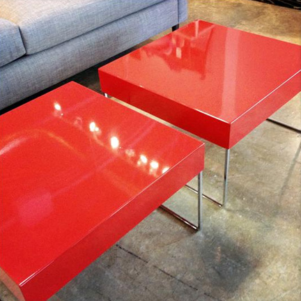 Red lacquer side tables or bunching tables, available at Five Elements Furniture in Austin, TX for $150 each.