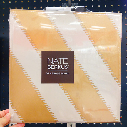 A gold striped dry erase board by Nate Berkus at Target.