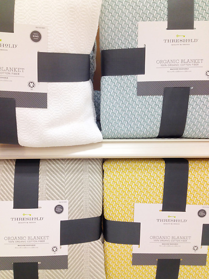 Pretty blankets by Threshold in white, aqua blue, yellow and gray, at Target.