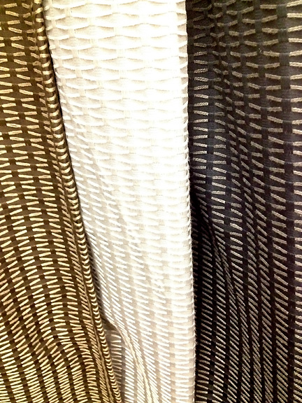 Nate Berkus curtain panels in gray, white and brown with stitched detail, at Target.