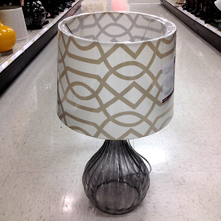 A modern gray glass table lamp base and trellis printed lamp shade at Target.